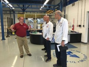 RAMTEC coordinator Ritch Ramey talking with Nissin Reps Andy Hentz and Jeff Johnston and Mark Hardin with Sandvik.
